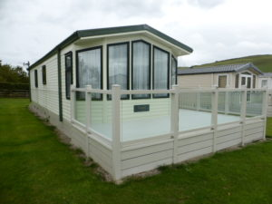 Willerby Aspen 2008 37x12x3 sited connected decking included on groesfforydd Image